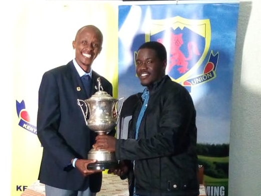 David Nduva, Winner, trophy presented by Mr. Lucas Maranga, KGU Chairman