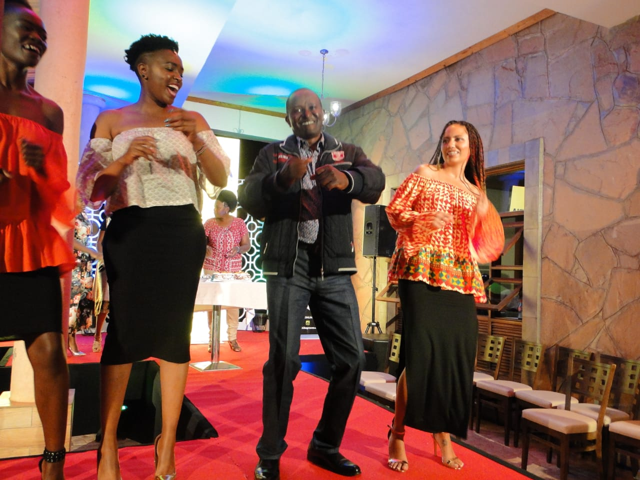 Hon Jamleck Kamau dancing with the models